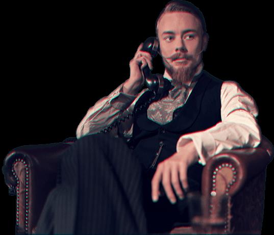 gentlemen sat in armchair on the phone