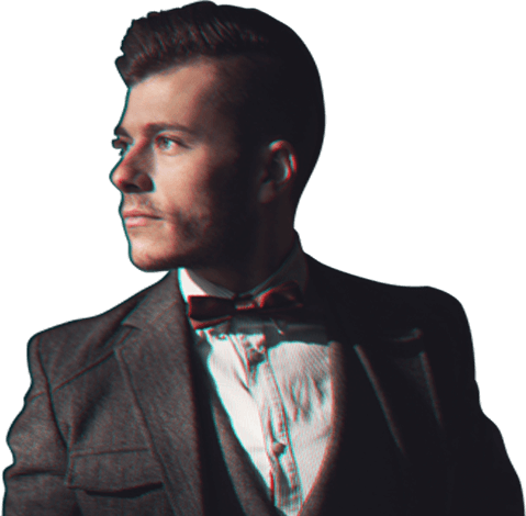 guy looking to the left in a suit and bow tie
